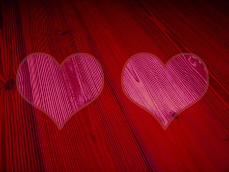 Two romantic vintage pink hearts on red old wood photo