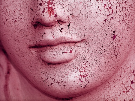 pales: Female crackled old face skin of a sculpture, rejuvenation concept Stock Photo