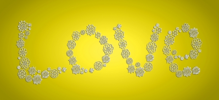 Love word in vintage knitted flowers over bright yellow background photo