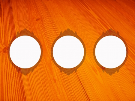 warmth: Three white empty circular frames over old warmth wood background Stock Photo