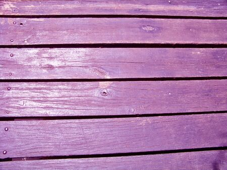 Purple old wood surface background in stripes