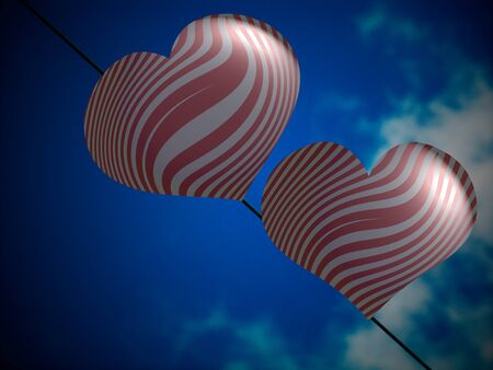 Couple of silver and red balloons flying with the blue sky photo
