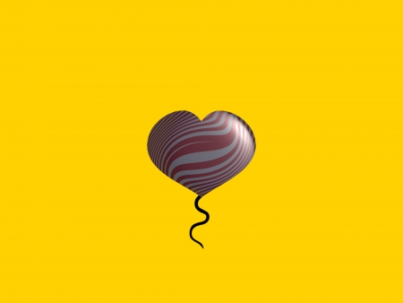Metallic balloon floating over yellow background photo