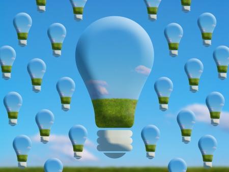 Surrealist creative image of eco friendly bulbs of light photo