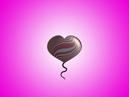 Heart balloon on pink background photo