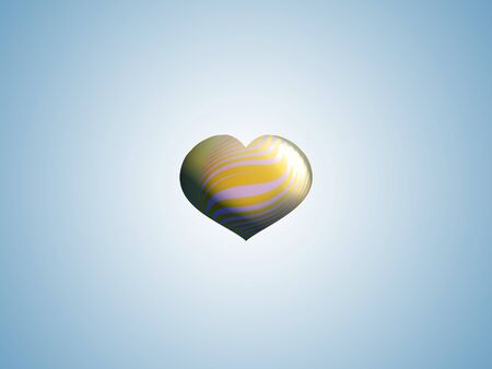 Small gold heart in light blue background photo