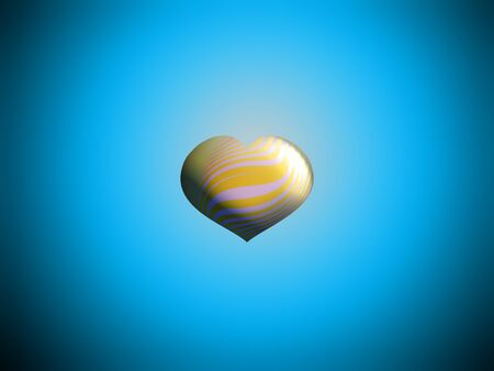 Small yellow heart in blue background photo