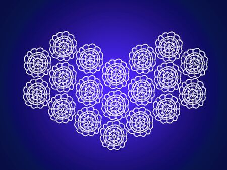 White crochet heart over indigo blue xmas background photo