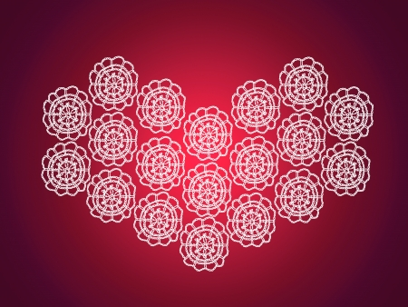 crafted: Homemade crafted heart of crochet over red xmas background Stock Photo