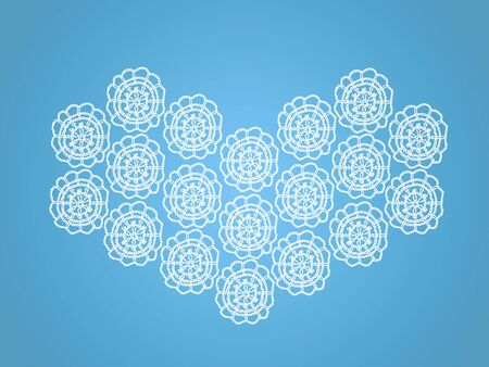 White crochetted heart over light blue photo