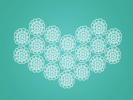 Vintage crochet heart made of circles over turquoise green background photo