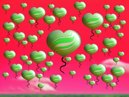 Thousand of green balloons with heart shape over pink red sky for Christmas photo