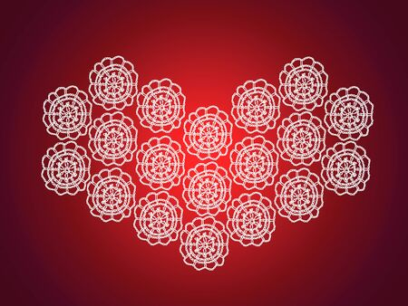 Red Christmas background with white knitted vintage crochet heart photo