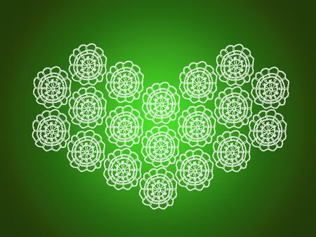 Green xmas backdrop with white heart of crochet laces photo