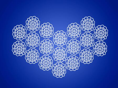 White knitted heart over blue backdrop photo