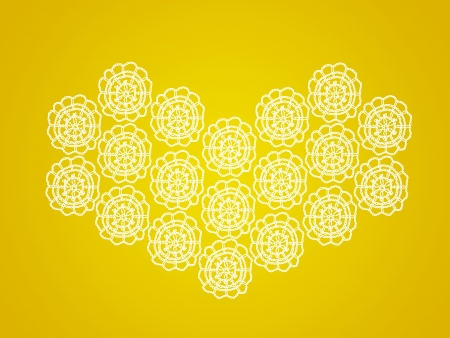 Bright yellow background with white heart of crochet circles photo