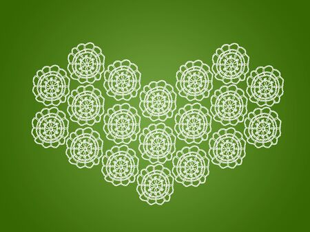 Green backdrop with white heart of old knitted circles in crochet photo