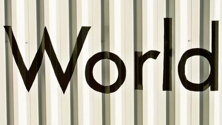 bn: Palabra mundo negro en una pared blanca Foto de archivo