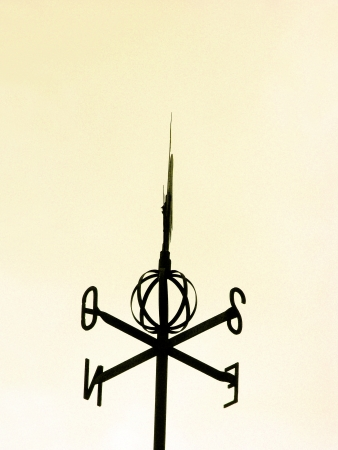 Vintage weathervane silhouette in black isolated over white sky Stock Photo - 17224522