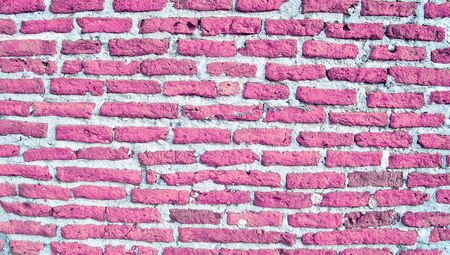 romaticism: Pink colored bricks of a rustic vintage recycled wall