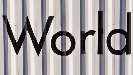 typographies: World word in black and white on a metallic real wall