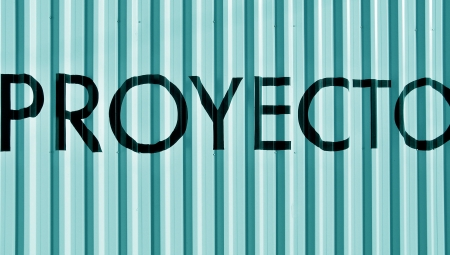 Proyecto, proyect word on a real metallic wall in greenish light blue Stock Photo - 17226958