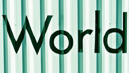 typographies: World word over green metallic wall backdrop