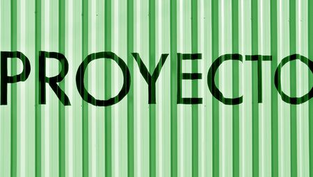 typographies: Proyecto, proyect word over green metallic wall background