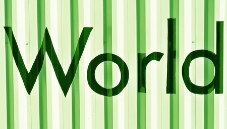 typographies: World over green metallic colored wall