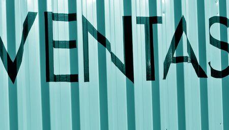 typographies: Ventas sales word on cyan metallic background