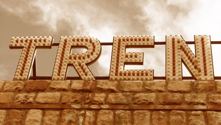 typographies: Vintage train billboard letters in sepia in spanish