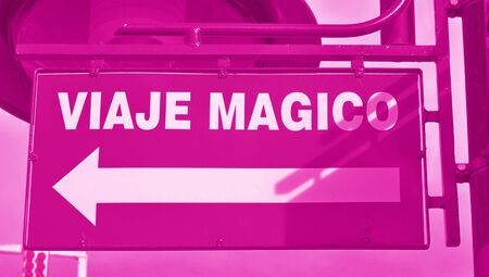 Magical trip sign in spanish with an arrow Stock Photo - 17508748