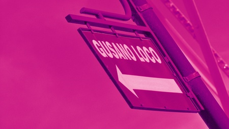 typographies: Purple street signal background with an arrow and words crazy worm