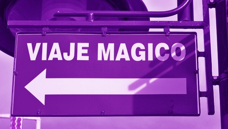 typographies: Violet urban signal with magic trip words in spanish Stock Photo