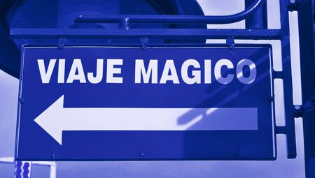 typographies: Magic trip words in spanish over an arrow in a  street sign