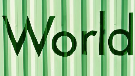 typographies: World word in black over green metallic background