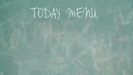 Today menu space for text on a green blackboard written with chalk photo
