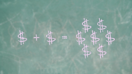 multiplying: Dollars signs in pink chalk in mathematic economy class Stock Photo