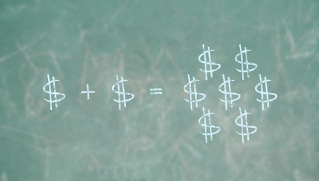 multiplying: Money attracts money concept with dollars signs on a blackboard