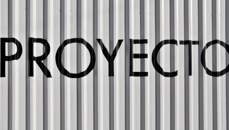 typographies: Proyect word on metallic striped background in black and white