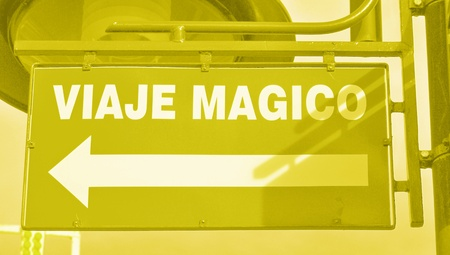 typographies: Yellowish light green colored street signal to a magic trip