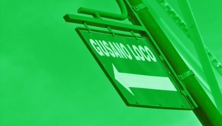 typographies: Green street sign with an arrow in perspective Stock Photo
