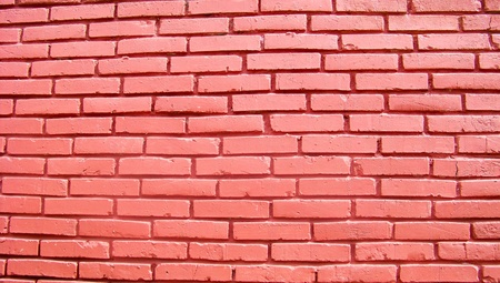 Red wall of bricks as texture or background photo