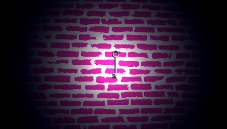 Light on silver key hanging on pink wall of bricks background photo