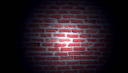 Brickwall illuminated by a lantern light in darkness photo