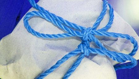 pack string: Blue gift pack closeup Stock Photo