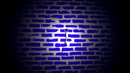 mistery: Silver key illuminated hanging on dark blue brickwall in darkness of night Stock Photo