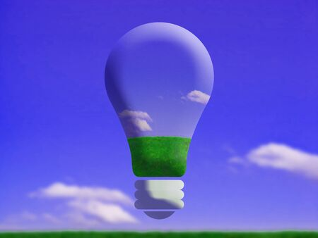 Giant lightbulb globe balloon flying on blue sky on green grass photo