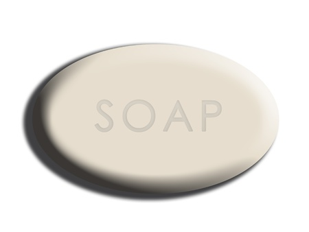 carved letters: White oval soap close-up isolated illustration