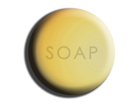 Yellow soft rounded circle of soap isolted on white photo